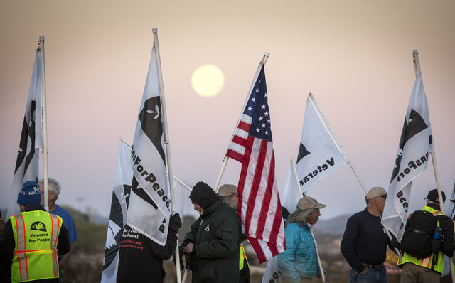 Anit-drone protester gather near the  south entrance to Creech Air Force Base at Indian Springs on Friday, March 6, 2015. Nearly 150 anti-drone warfare protesters gathered with 33 protestors being ...