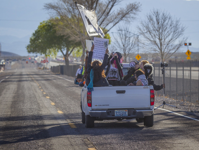 Anti-drone warfare protesters drive along Creech Air Force Base at Indian Springs on Friday, March 6, 2015. Thirty-three protesters were cited for pedestrian in the road charges during a march to  ...