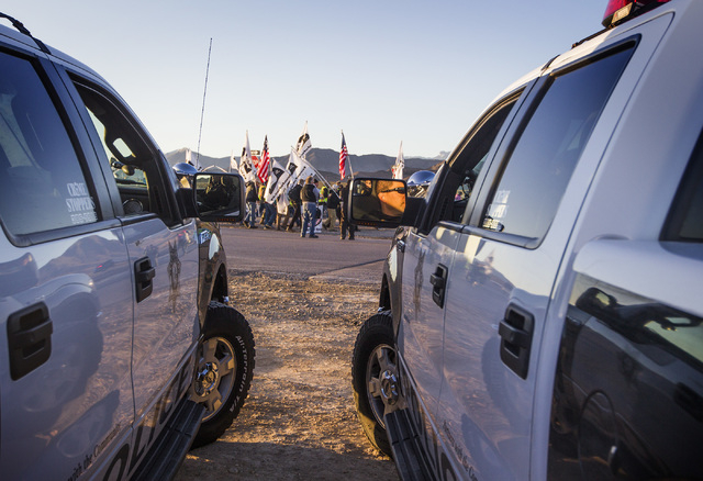 Las Vegas police monitor anti-drone demonstrators near the south entrance of  Creech Air Force Base in Indian Springs on Friday, March 6, 2015. Thirty-three protesters were cited for pedestrian in ...