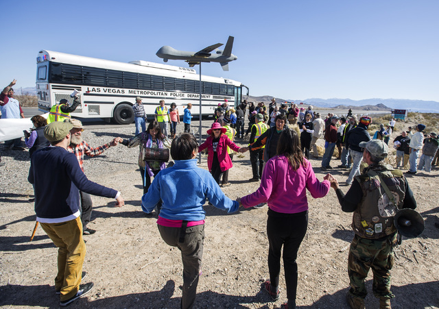 Anti-drone warfare protesters dance after being release by Las Vegas police across the street from  Creech Air Force Base at Indian Springs on Friday, March 6, 2015. Thirty-three protesters were c ...