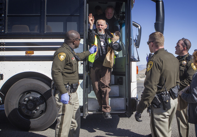 Father Louis Vatale, a priest form Oakland, Cal., cheers after being release by Las Vegas police during an anti-drone protest at  Creech Air Force Base in  Indian Springs on Friday, March 6, 2015. ...