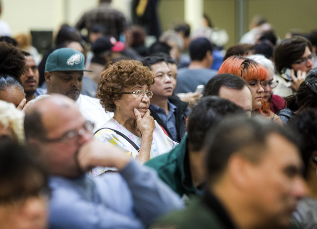 People sit  at the Department of Motor Vehicles office, 2701 E. Sahara Avenue on Friday, Jan. 17, 2014. (Jeff Scheid/Las Vegas Review-Journal)