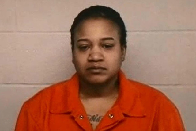 Mitchelle Angela Blair, 35, of Detroit, is being held on charges of felony child abuse while medical examiners try to determine whether two of her children, whose bodies were found in a freezer in ...