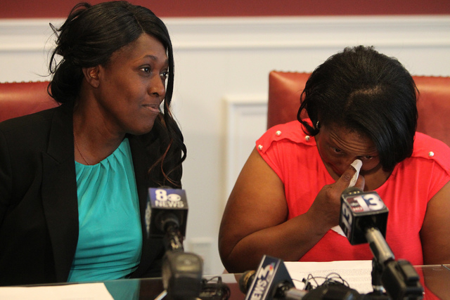 Nychele Thomas, left, and Angela Gilmore, mothers of two teenagers who died in a crash with a drunk driver on March 5, get ready to  speaks to the media during a press conference at the Harris and ...