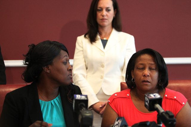 Nychele Thomas, left, and Angela Gilmore, mothers of two teenagers who died in a crash with drunk driver on March 5, speak to the media with their attorney Heather Harris during a press conference ...