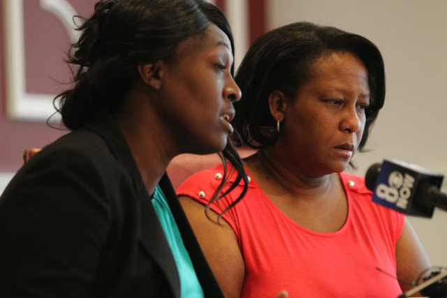 Nychele Thomas, left, and Angela Gilmore, mothers of two teenagers who died in a crash with a drunk driver on March 5, speak to the media during a press conference at the  Harris and Harris Law Fi ...