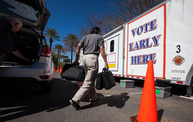 Clark County employee Jaime Mondala works on setting up a mobile trailer for early voting for the Las Vegas municipal elections at Trails Village Center, 1940 Village Center Circle in the Summerli ...