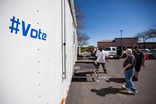 Clark County employees work on setting up a mobile trailer for early voting for the Las Vegas municipal elections at Trails Village Center, 1940 Village Center Circle in the Summerlin area of Las  ...