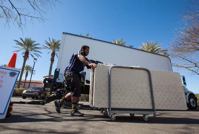 Clark County employee Tashon Young moves tables and other items while setting up a mobile trailer for early voting for the Las Vegas municipal elections at Trails Village Center, 1940 Village Cent ...