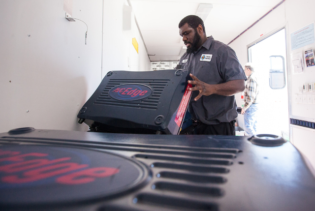 Clark County employee Chad Carter sets up voting machines in a mobile trailer for early voting for the Las Vegas municipal elections at Trails Village Center, 1940 Village Center Circle in the Sum ...