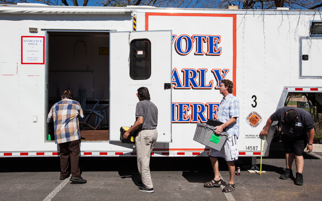 Clark County employees and paid volunteers, from left, David Shackelford, Jaime Mondala, Dane Deno and Roman Pacheco work on setting up a mobile trailer for early voting for the Las Vegas municipa ...