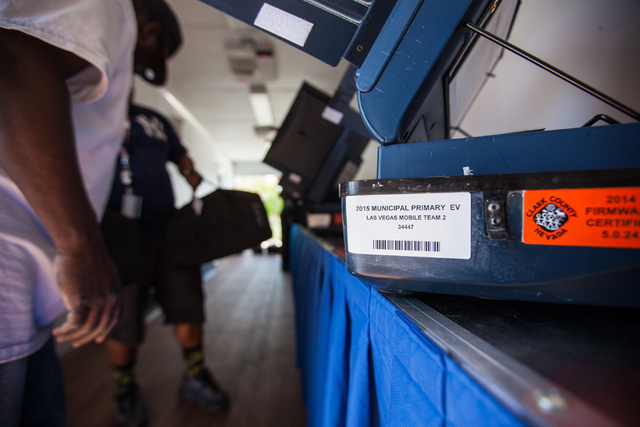 A tag is seen on a voting machine during set up in a mobile trailer for early voting for the Las Vegas municipal elections at Trails Village Center, 1940 Village Center Circle in the Summerlin are ...