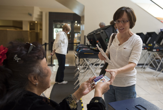Shelia Soloman, right, recieves her I voted sticker during early voting at Meadows Mall in Las Vegas on Saturday, Mar. 21, 2015. (Martin S. Fuentes/Las Vegas Review-Journal)