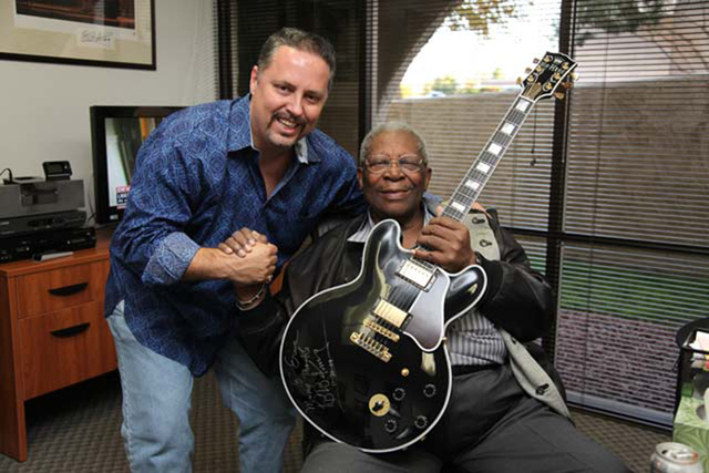 """Eric Dahl and B.B. King pose with """"Lucille"""" in this 2009 photo. (Courtesy, Ted Vandell)"""