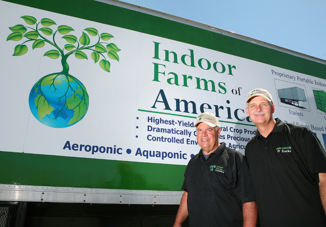 Indoor Farms of America principals Ronald Evans, left, and David Martin stand outside their grow truck Monday, March 30, 2015, in Henderson. Indoor Farms of America owners plan to exhibit their 19 ...