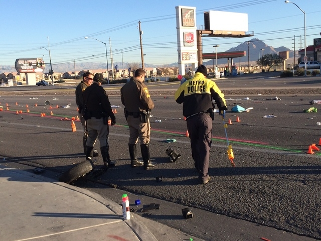 Police investigate the scene where two women were killed in a two-vehicle crash at Boulder Highway and Russell Road early Thursday morning, March 5, 2015. The driver of the second vehicle was arre ...