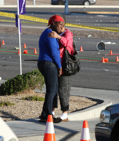 The mother of one of the victims who died in a fatal car accident, left, comforted by a family friend near the accident scene where two women were killed Thursday, March 5, 2015, at Russell Road a ...