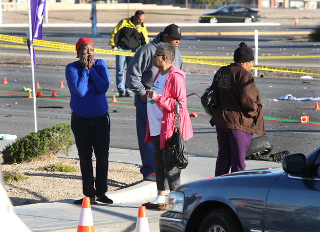 The mother of one of the victims who died in a fatal car accident, left, reacts near the accident scene where two women were killed Thursday, March 5, 2015, at Russell Road and Boulder Highway. (B ...