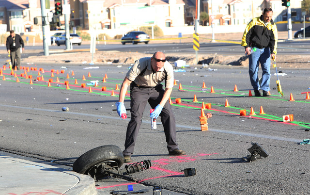 Metro Police investigate the accident where two women were killed Thursday, March 5, 2015, at Russell Road and Boulder Highway. (Bizuayehu Tesfaye/Las Vegas Review-Journal)