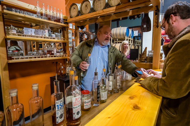 Owner George Racz serves tastings of alcohol during a tour Jan. 20, 2015, of the Las Vegas Distillery, 7330 Eastgate Road, Suite 110. (Fernando Lopez/Special to View)