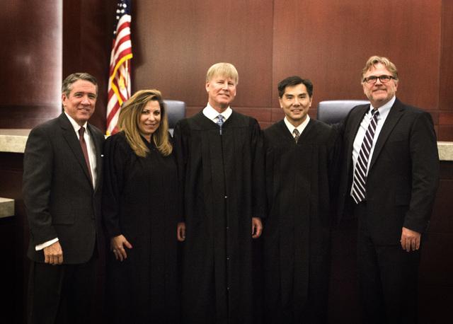 Daniel Polsenberg, left, representing Pentair Water Pool and Spa Inc., Nevada Court of Appeals Judges Abbi Silver, left,  Michael Gibbons, Jerome Tao and Robert Winner, representing Las Vegas resi ...