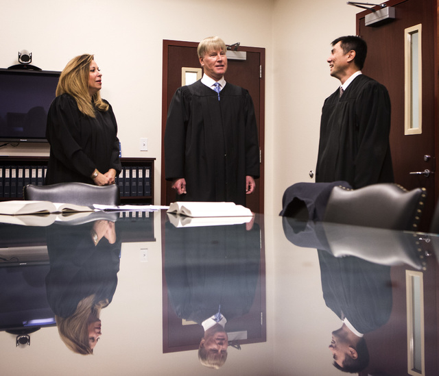 Nevada Court of Appeals Judges Abbi Silver, left, Michael Gibbons and Jerome Tao talk in chambers before the first Court of Appeals hearing on Wednesday, March 25, 2015, at the Regional Justice Ce ...