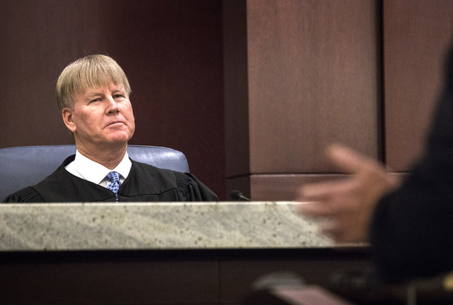Nevada Court of Appeals Chief Judge Michael Gibbons listens to arguments during the first Court of Appeals hearing on Wednesday, March 25, 2015 at the Regional Justice Center, 200 Lewis Ave. The a ...