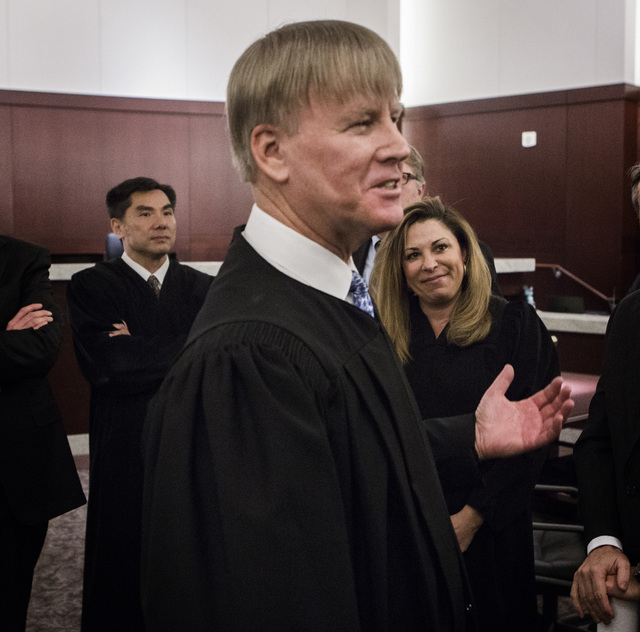 Nevada Court of Appeals Judges Jerome Tao, left, Michael Gibbons and Abbi Silver talk to court counsel after the first Court of Appeals hearing on Wednesday, March 25, 2015, at the Regional Justic ...