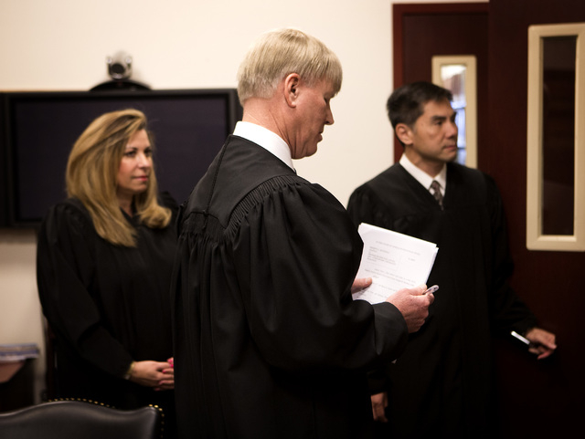 Nevada Court of Appeals judges Abbi Silver, left, Michael Gibbons and Jerome Tao prepare in chambers before the first Court of Appeals hearing on Wednesday, March 25, 2015, at the Regional Justice ...