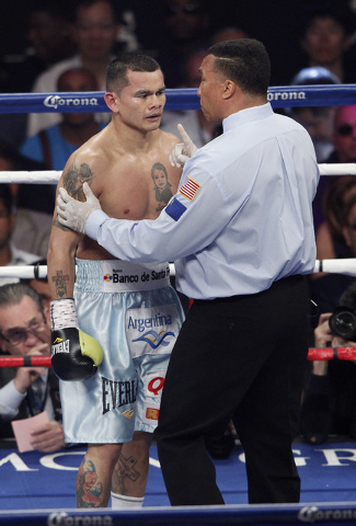 Referee Tony Weeks speaks with Marcos Maidana during his welterweight title bout at the MGM Grand in Las Vegas Saturday, May 3, 2014. (John Locher/Las Vegas Review-Journal)
