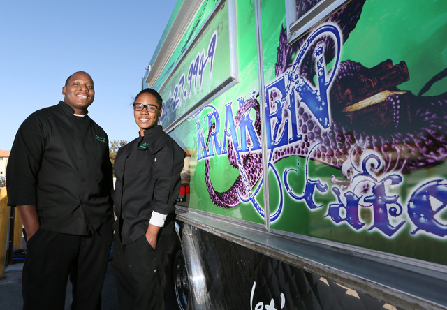 Owners Elijahwan Bonner (cq), left, and Kayla Webster stand next to their Kraken Cafe food truck at AAA Restaurant and Bar Supply Friday, March 6, 2015, in Las Vegas. Kraken Cafe won the American  ...