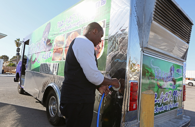 Co-owner Elijahwan Bonner (cq) pumps water into his Kraken Cafe food truck at AAA Restaurant and Bar Supply Friday, March 6, 2015, in Las Vegas. Kraken Cafe won the American Small Business Champio ...
