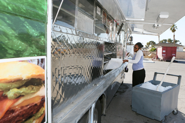 Co-owner Kayla Webster loads ice into her Kraken Cafe food truck at AAA Restaurant and Bar Supply Friday, March 6, 2015, in Las Vegas. Kraken Cafe won the American Small Business Championship, whi ...