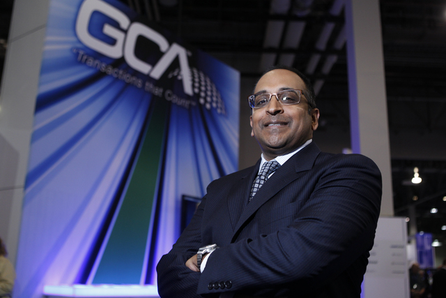 Ram Chary, chief executive officer for Global Cash Access,  poses for a portrait at the GCA booth at the Global Gaming Expo at Sands Expo and Convention Center in Las Vegas Wednesday, Oct. 1, 2014 ...