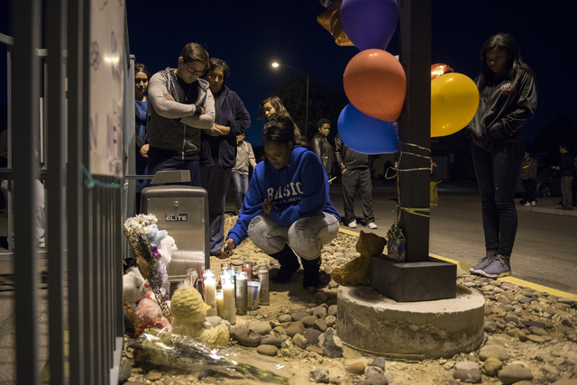 Neighbors, family and friends remember 8-year-old Matthew Cattlet during a candlelight vigil at the Village at Craig Ranch community in North Las Vegas Wednesday Mar. 4, 2015.  Cattlet died on Tue ...