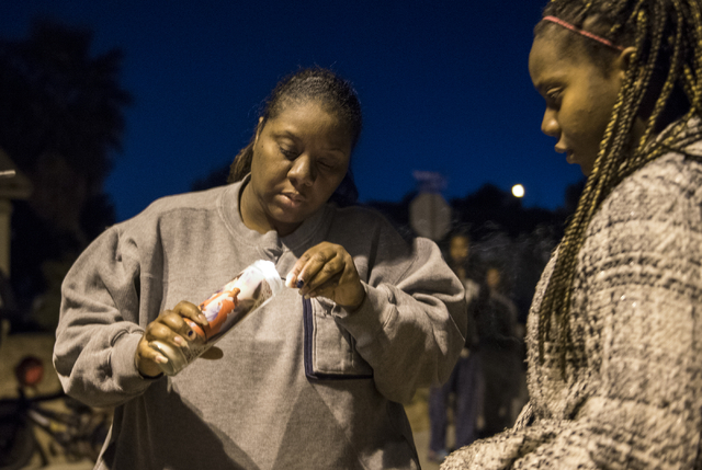 Friends Anna Jones and Lyitianie Macklin honor 8-year-old Matthew Cattlet during a candlelight vigil at the Village at Craig Ranch community in North Las Vegas Wednesday Mar. 4, 2015. Cattlet died ...