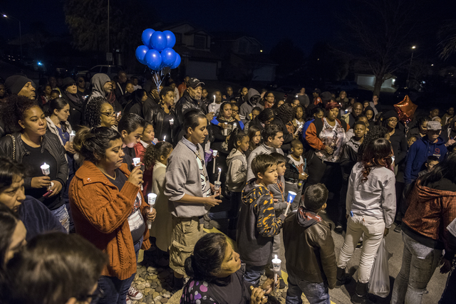 Neighbors, family and friends remember 8-year-old Matthew Cattlet during a candlelight vigil at the Village at Craig Ranch community in North Las Vegas Wednesday Mar. 4, 2015. Cattlet died on Tues ...