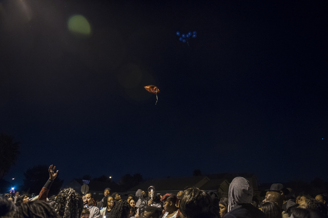 Balloons are released during a candlelight vigil for 8-year-old Matthew Cattlet at the Village at Craig Ranch community in North Las Vegas Wednesday Mar. 4, 2015. Cattlet died on Tuesday after get ...