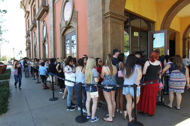 Hundreds wait in line at the annual Gown Town event, sponsored by HELP of Southern Nevada, which provides high school students with an affordable alternative for prom dress shopping (Sam Morris/La ...