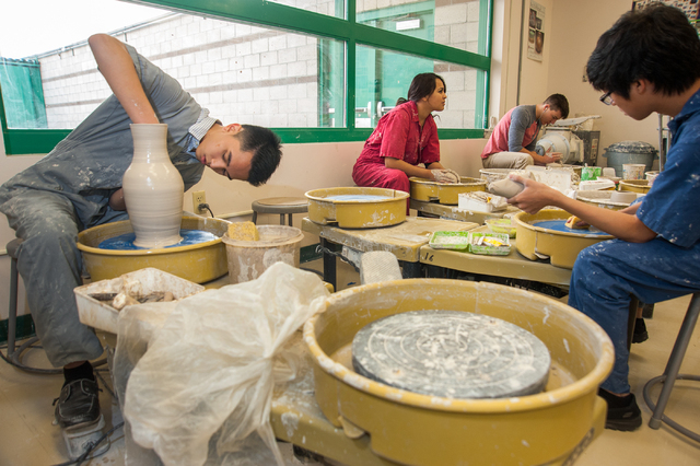 Green Valley High School students from left, Matthew Chen, 17, Stephanie Sarabia, 17, Manhal Jadid, 17, and Ryan Desacola, 16, wheel throw clay bowls during their Ceramics 1 class at Green Valley  ...
