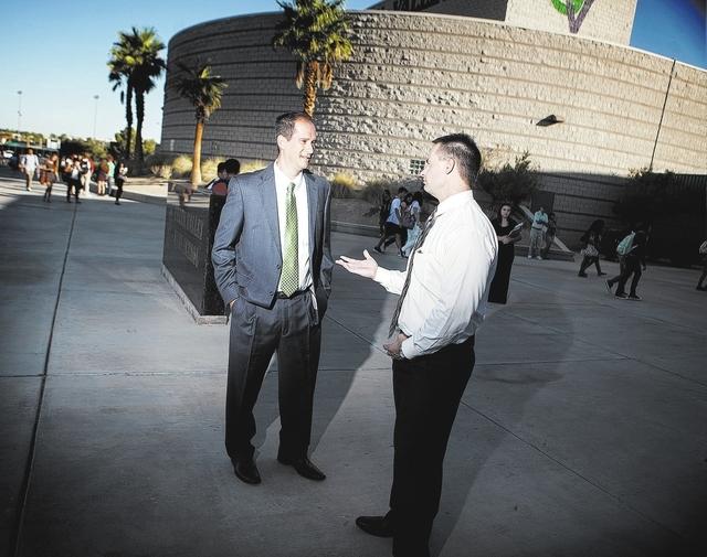 Former Green Valley High School principal Jeff Horn talks to current principal Kent Roberts in front of the school at 460 Arroyo Grande Boulevard on Wednesday, Aug. 27,2014. (Jeff Scheid/Las Vegas ...