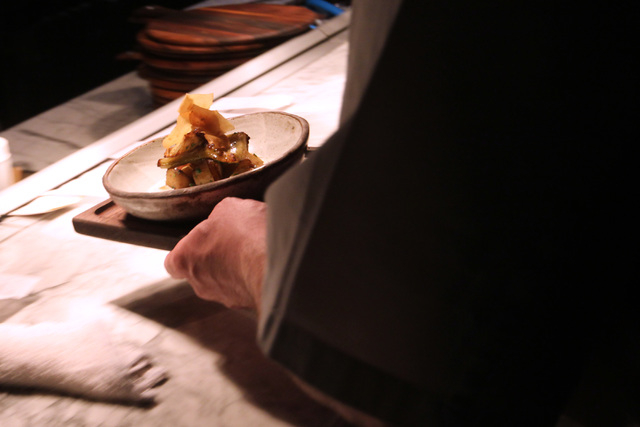 A member of the kitchen staff places a plated up menu item for delivery to a customer at the Hearthstone restaurant inside the Red Rock Resort hotel-casino in Las Vegas, Thursday, March 19, 2015.  ...