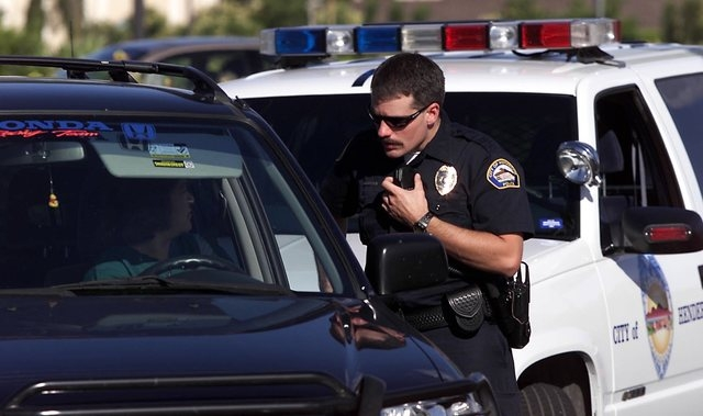 A Henderson police officer talks with a motorist after making a traffic stop in Henderson in this 2001 file photo. (Amy Beth Bennett/Las Vegas Review-Journal)