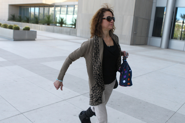 Edith Gillespie, co-defendant in a federal case involving fraud and corruption at Las Vegas homeowners associations, walks to Lloyd George Federal Courthouse in Las Vegas Wednesday, Feb. 25, 2015. ...