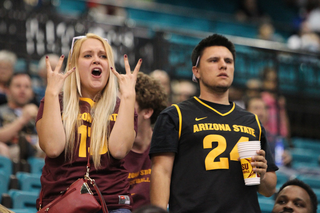 Arizona State Wildcats fans Lisa Gilliland, left, and her boyfriend Marc Arroyo cheer for their team before the start of the game against University of Southern California Trojans in the men's bas ...