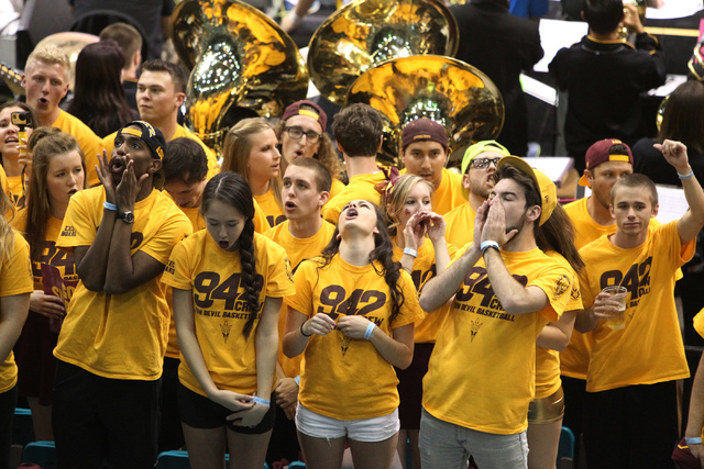 Arizona State Wildcats fans boo their team's opponents before the start of their game against the University of Southern California Trojans in the men's basketball Pac-12 tournament inside the MGM ...