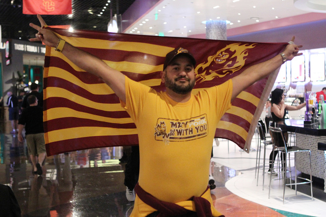 Bryan Gershweir flies his Arizona State flag as he walks to the men's basketball game at the Grand Garden Arena for a Pac-12 tournament game inside the MGM Grand casino-hotel in Las Vegas Wednesda ...
