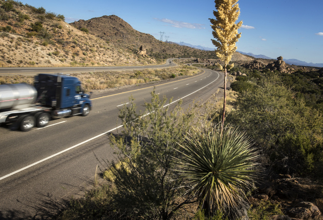 Southbound truck on U.S. 93 as seen Monday, Nov. 18, 2013 at Wikieup, Ariz. Nevada and Arizona lawmakers and businessmen are supporting a proposal to create a new interstate to connect Mexico, Uni ...