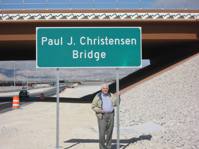 Paul Christensen posed for a photo in January 2014 at the bridge sign that was named for him. (Special to View)