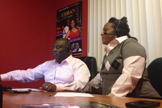 """Robert and Pamela Rickenbacker work inside their home office in North Las Vegas during """"The Mr. R Show,"""" which showcases independent and unsigned hip-hop and R&B artists from around the world, Mar ..."""